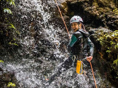 Canyoning in Bali. Gorges, cliff jumps and rappelling from the height of 15 meters